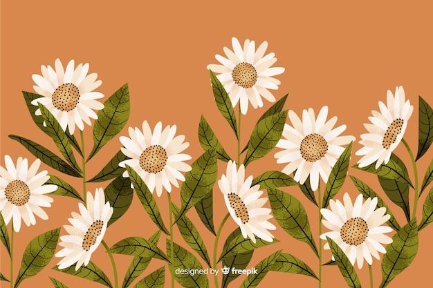 Fond naturel avec des fleurs dessinées à la main