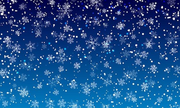 Fond de neige. chutes de neige en hiver. flocons de neige blancs sur ciel bleu. fond de noël. chute de neige.