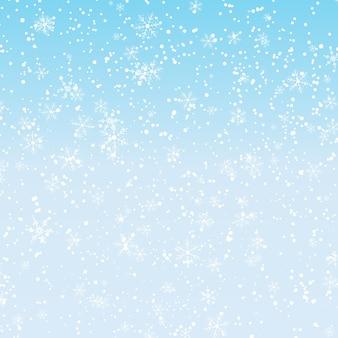 Fond de neige. chutes de neige d'hiver. flocons de neige blancs sur ciel bleu. fond de noël. chute de neige.