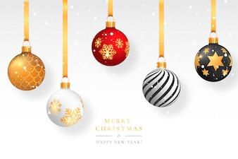 Fond neigeux de Noël avec des boules élégantes