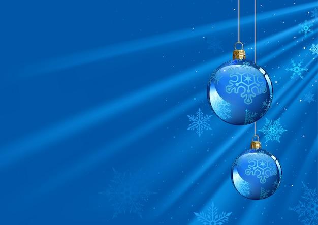 Fond de noël bleu avec des boules et des faisceaux lumineux