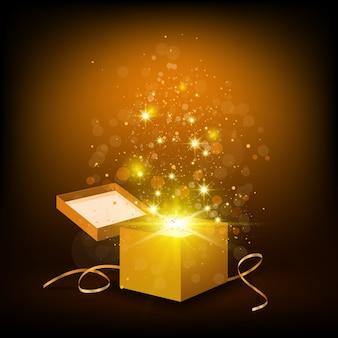 Fond de noël avec boîte dorée ouverte avec des confettis