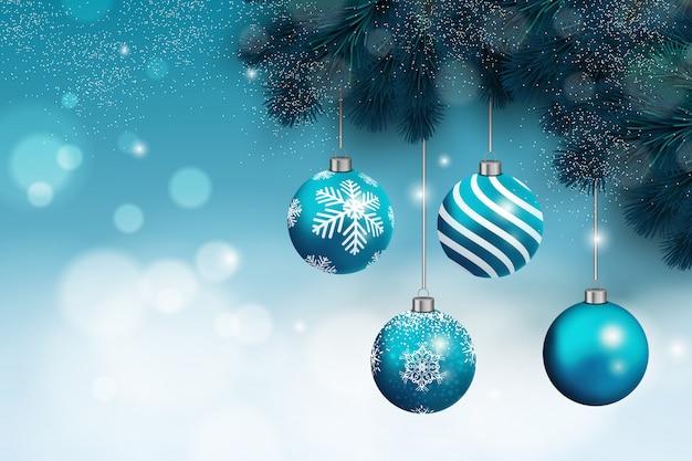 Fond de noël avec des boules de noël bleues et de la neige