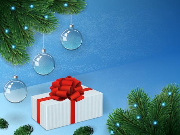Fond de noël avec des boules transparentes, épinette, guirlande et cadeau.