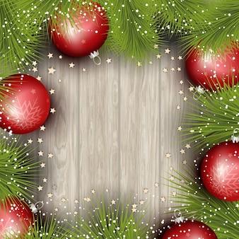 Fond de noël avec des branches d'arbres de pin boules et étoiles sur une texture bois