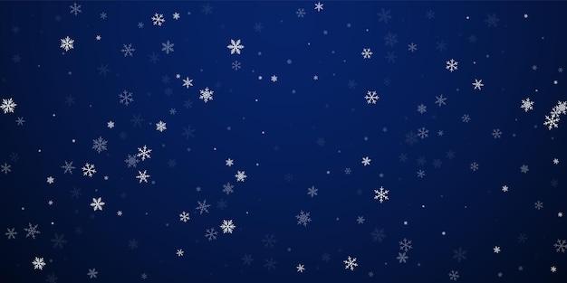 Fond de noël de chutes de neige clairsemées. flocons de neige volants subtils et étoiles sur fond de nuit bleu foncé. superbe modèle de superposition de flocon de neige en argent d'hiver. belle illustration vectorielle.