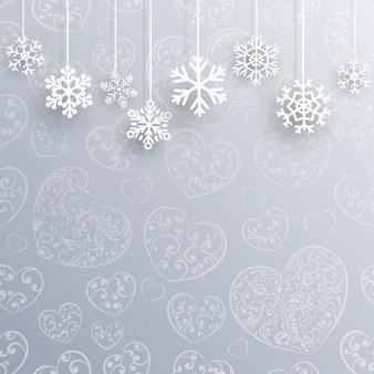 Fond de noël avec des coeurs et des flocons de neige dans des couleurs bleu clair