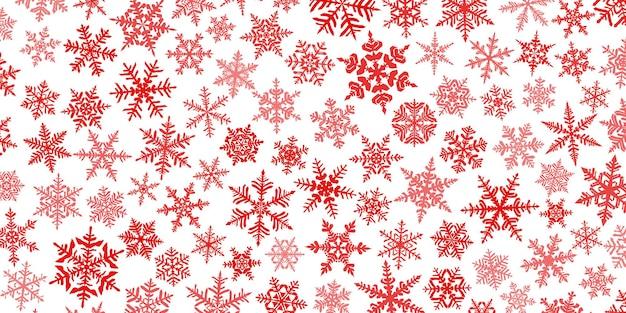 Fond de noël avec divers flocons de neige complexes, grands et petits, rouge sur blanc