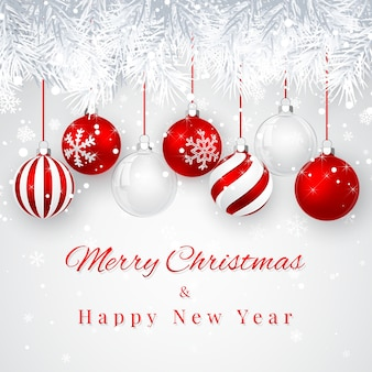 Fond de noël et du nouvel an avec des boules de noël rouges, branche de sapin et neige pour noël