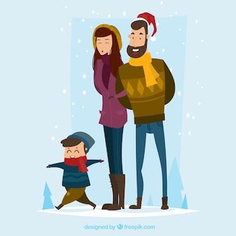 Fond de noël avec une famille marchant sous la neige
