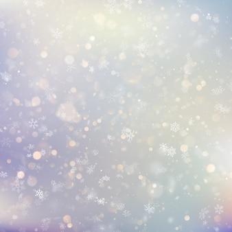 Fond de noël avec des flocons de neige floues blanches.