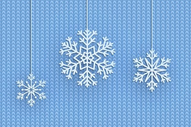 Fond de noël avec des flocons de neige suspendus décoratifs