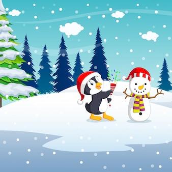 Fond de noël hiver avec bonhomme de neige à la main de pingouin