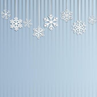 Fond de noël avec plusieurs flocons de neige suspendus sur fond rayé bleu clair