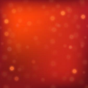 Fond de noël rouge avec des lumières de bokeh.