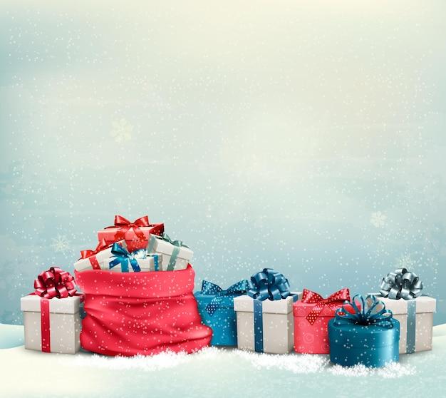 Fond de noël de vacances avec un sac plein de coffrets cadeaux