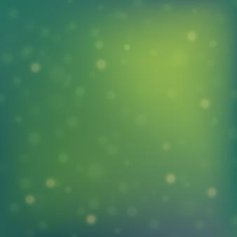 Fond de noël vert avec des lumières de bokeh.