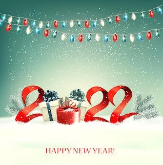 Fond de nouvel an 2022 avec coffrets cadeaux et guirlande colorée. vecteur.