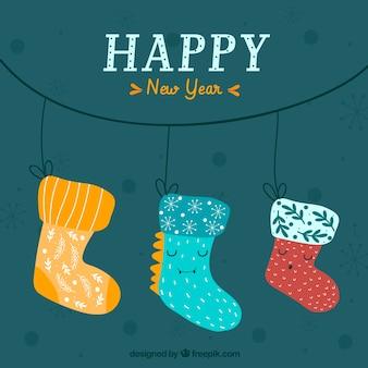 Fond de nouvel an avec des chaussettes mignons dessinés à la main