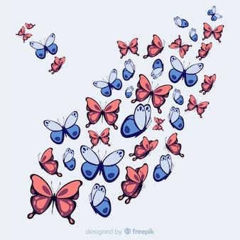 Fond de papillon essaim dessiné à la main
