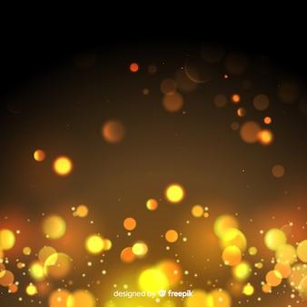 Fond de particules d'or dans le style bokeh