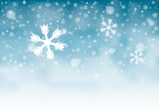 Fond de paysage d'hiver flou avec des flocons de neige