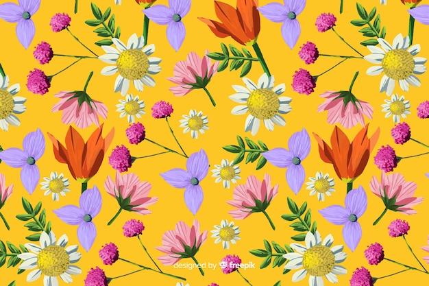 Fond peint avec des fleurs à la main