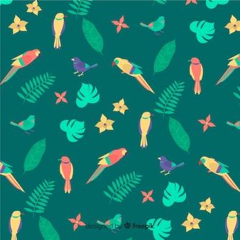 Fond plat de feuilles et de fleurs tropicales