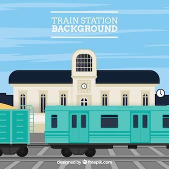Fond plat avec gare et bâtiment