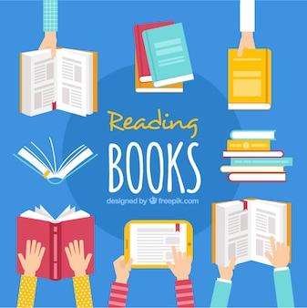 Fond plat des mains tenant des livres