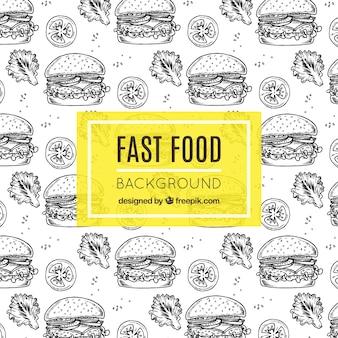 Fond de restauration rapide avec hamburgers à la main