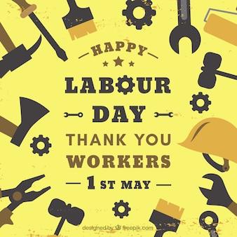 Fond rétro avec des outils pour la journée internationale des travailleurs