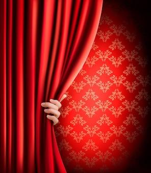 Fond avec rideau de velours rouge et main.