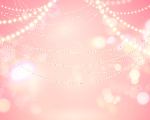 Fond rose bokeh scintillant avec décoration d'ampoules d'éclairage