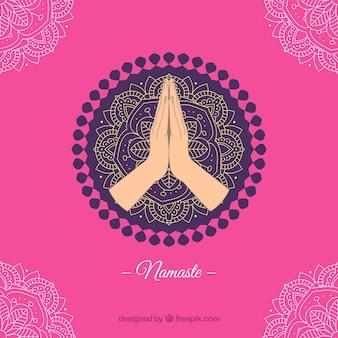 Fond rose avec mandala et namaste salutation