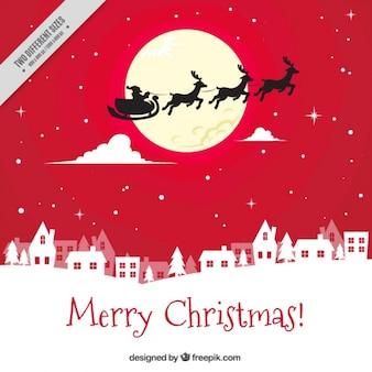 Fond rouge du Père Noël volant au-dessus de la ville