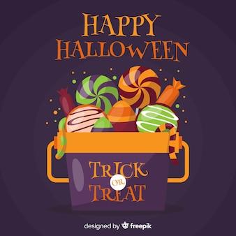 Fond de sac de bonbons colorés halloween dans un design plat
