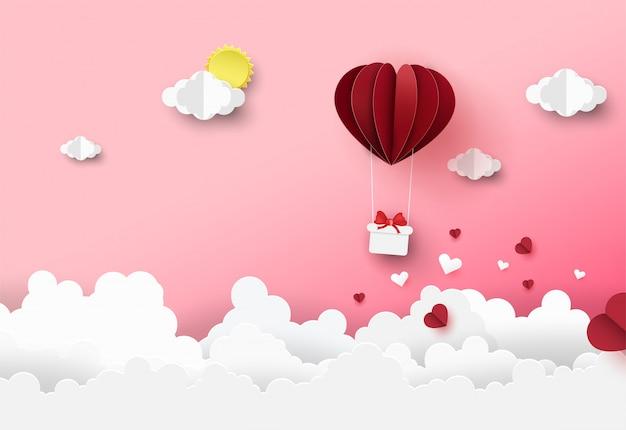 Fond de saint valentin avec ballon flottant origami sur nuage.