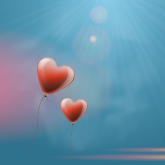 Fond de la saint-valentin avec des ballons en forme de coeur.