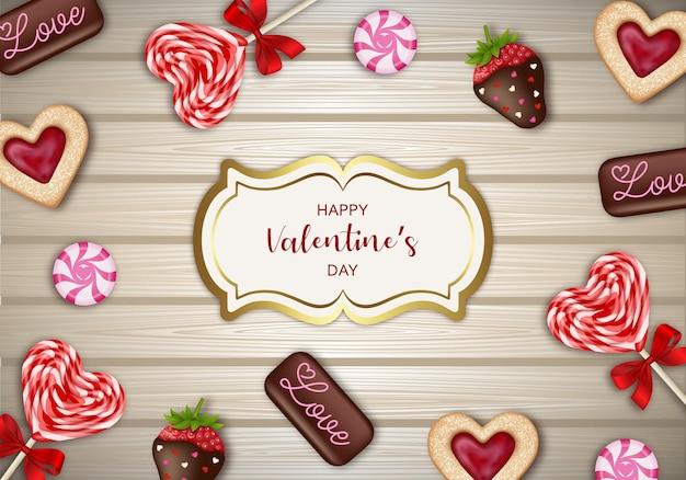 Fond de la saint-valentin avec des bonbons, des chocolats et des biscuits