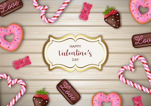 Fond de la saint-valentin avec des bonbons, des chocolats et des bonbons