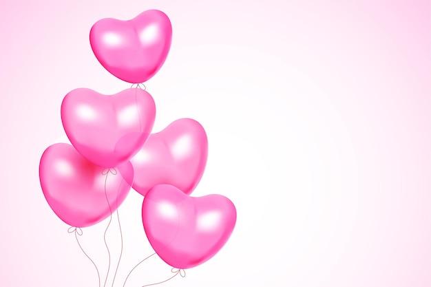 Fond de saint valentin avec bouquet de ballons en forme de coeur sur rose dégradé