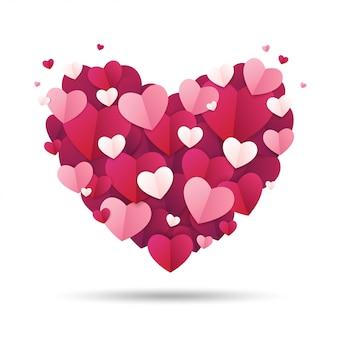 Fond de saint valentin. le coeur est décoré avec un petit papier en forme de coeur.