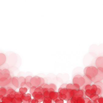 Fond de saint valentin avec des coeurs flous rouges