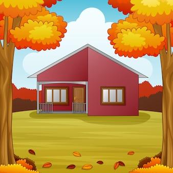 Fond de saison d'automne avec la maison rouge et les feuilles d'automne