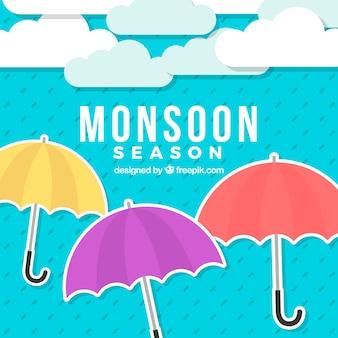 Fond de saison de mousson avec des parapluies colorés