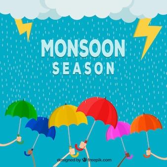Fond de saison de mousson avec des parapluies