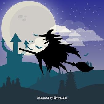 Fond de sorcière volant dans le paysage