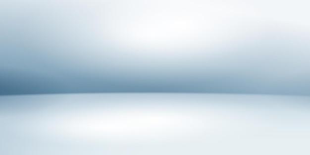 Fond de studio vide avec un éclairage doux dans des couleurs bleu clair
