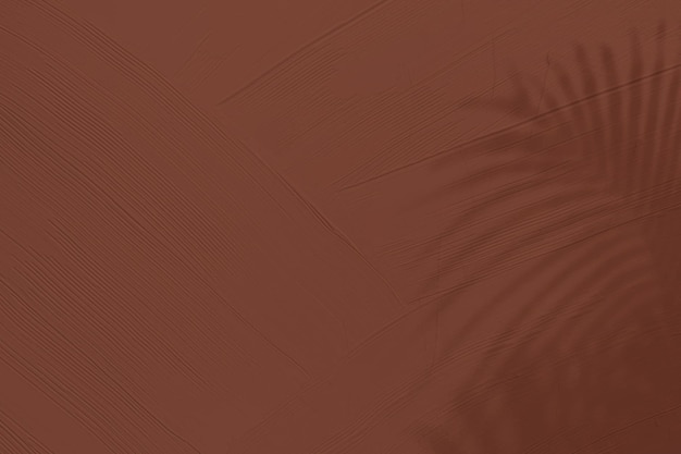 Fond texturé marron avec ombre de feuilles tropicales